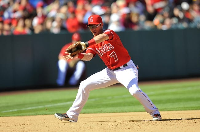 September 22, 2013; Anaheim, CA, USA; Los Angeles Angels shortstop Andrew Romine (7) fields a ground ball during the sixth inning against the Seattle Mariners at Angel Stadium of Anaheim. Mandatory Credit: Gary A. Vasquez-USA TODAY Sports