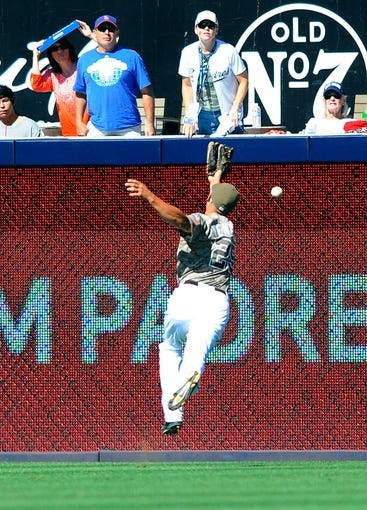 Sep 22, 2013; San Diego, CA, USA; San Diego Padres right fielder Will Venable (25) is unable to make a catch on a triple hit by Los Angeles Dodgers third baseman Michael Young (not pictured) during the seventh inning against the Los Angeles Dodgers at Petco Park. Mandatory Credit: Christopher Hanewinckel-USA TODAY Sports