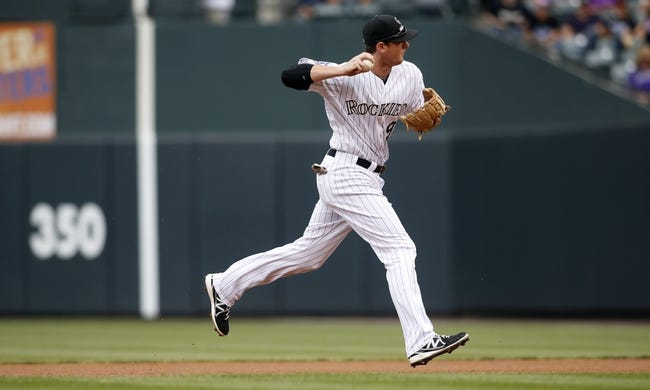 Sep 22, 2013; Denver, CO, USA; Colorado Rockies second baseman DJ LeMaieu (9) fields a ground ball during the first inning against the Arizona Diamondbacks at Coors Field. Mandatory Credit: Chris Humphreys-USA TODAY Sports