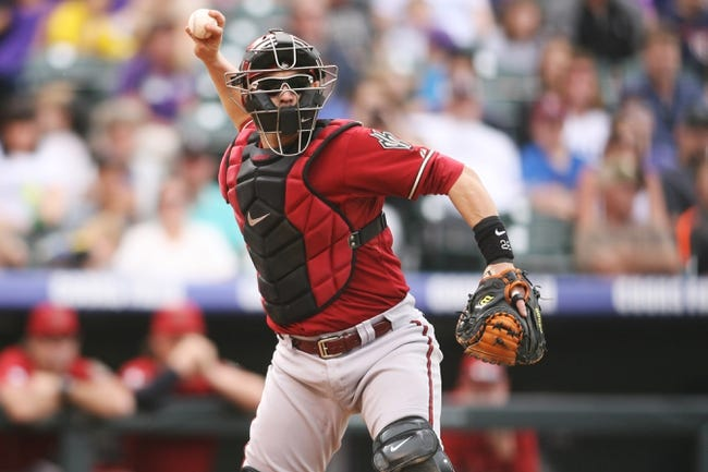 Sep 22, 2013; Denver, CO, USA; Arizona Diamondback catcher Miguel Montero (26) during the third inning against the Arizona Diamondbacks at Coors Field. Mandatory Credit: Chris Humphreys-USA TODAY Sports