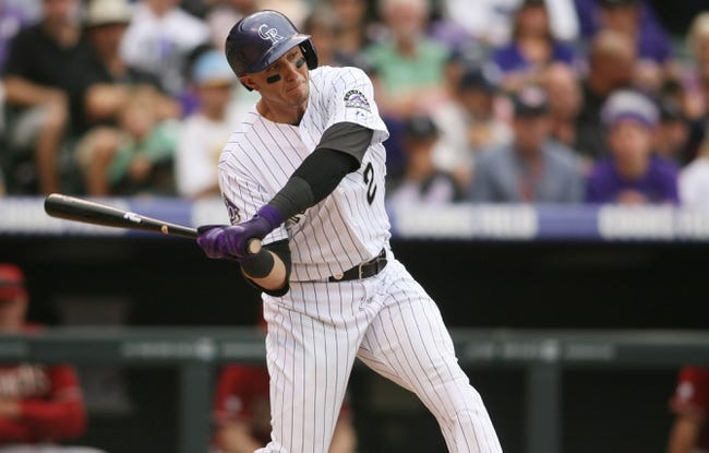 Sep 22, 2013; Denver, CO, USA; Colorado Rockies shortstop Troy Tulowitzki (2) hits a single during the third inning against the Arizona Diamondbacks at Coors Field. Mandatory Credit: Chris Humphreys-USA TODAY Sports
