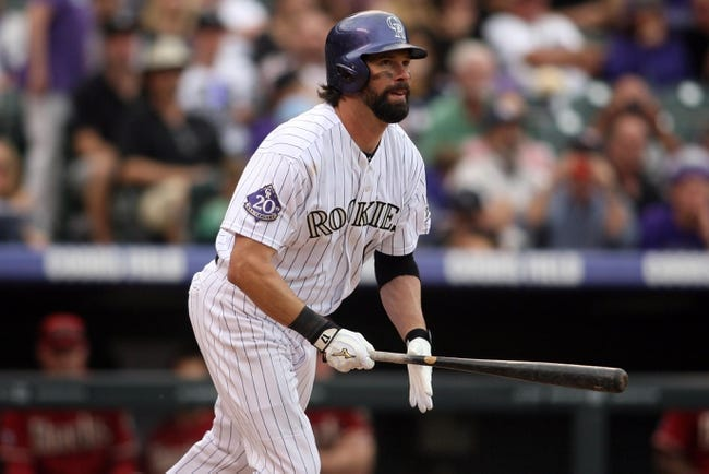 Sep 22, 2013; Denver, CO, USA; Colorado Rockies first baseman Todd Helton (17) hits a double during the fourth inning against the Arizona Diamondbacks at Coors Field. Mandatory Credit: Chris Humphreys-USA TODAY Sports