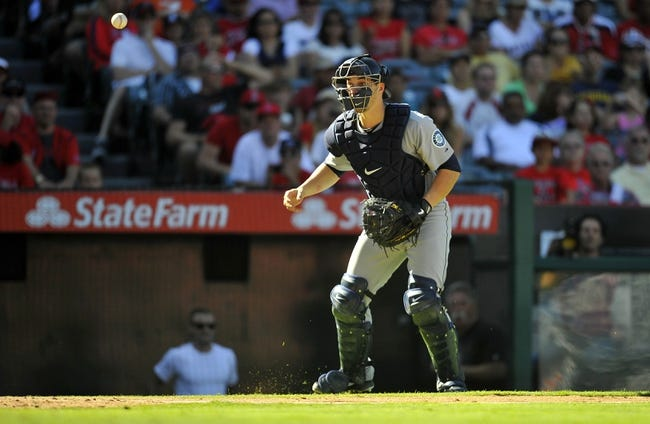 September 22, 2013; Anaheim, CA, USA; Seattle Mariners catcher Mike Zunino (3) mishandles the ball on a throw during the seventh inning against the Los Angeles Angels at Angel Stadium of Anaheim. Mandatory Credit: Gary A. Vasquez-USA TODAY Sports