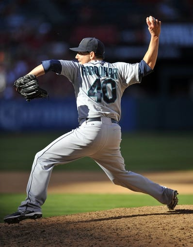 September 22, 2013; Anaheim, CA, USA; Seattle Mariners relief pitcher Danny Farquhar (40) pitches during the ninth inning against the Los Angeles Angels at Angel Stadium of Anaheim. Mandatory Credit: Gary A. Vasquez-USA TODAY Sports