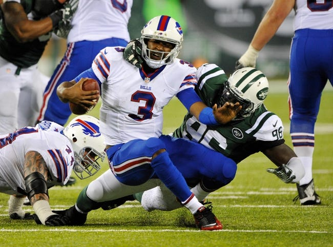 Sep 22, 2013; East Rutherford, NJ, USA; Buffalo Bills quarterback EJ Manuel (3) is sacked by New York Jets defensive end Muhammad Wilkerson (96) in the 4th quarter at MetLife Stadium. Mandatory Credit: Robert Deutsch-USA TODAY Sports