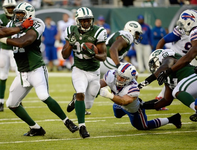 Sep 22, 2013; East Rutherford, NJ, USA; New York Jets running back Bilal Powell (29) with the ball against the Buffalo Bills at MetLife Stadium. Mandatory Credit: Robert Deutsch-USA TODAY Sports