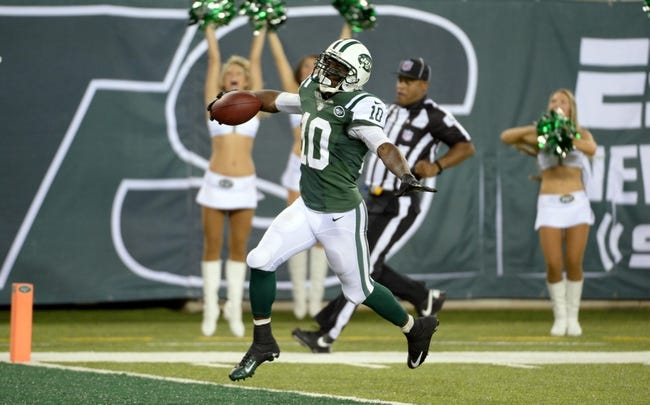 Sep 22, 2013; East Rutherford, NJ, USA; New York Jets wide receiver Santonio Holmes (10) scores a touchdown against the Buffalo Bills in the 4th quarter at MetLife Stadium. Mandatory Credit: Robert Deutsch-USA TODAY Sports