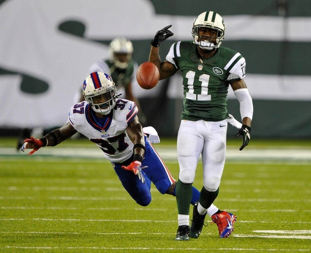 Sep 22, 2013; East Rutherford, NJ, USA; Buffalo Bills defensive back Nickell Robey (37) breaks up a pass to New York Jets wide receiver Jeremy Kerley (11) at MetLife Stadium. Mandatory Credit: Robert Deutsch-USA TODAY Sports