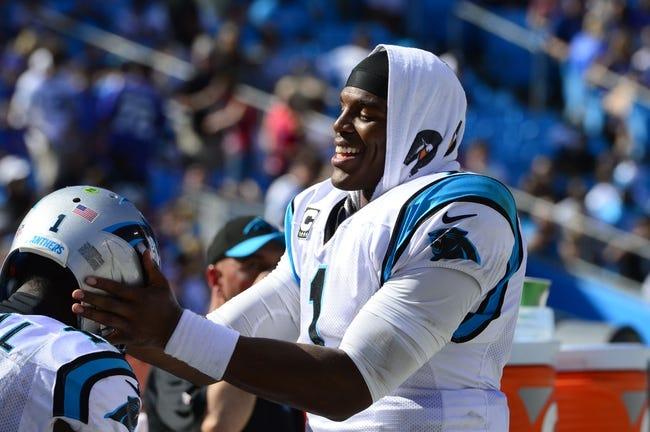 Sep 22, 2013; Charlotte, NC, USA; Carolina Panthers quarterback Cam Newton (1) with wide receiver Brandon LaFell (11) late in the fourth quarter. The Carolina Panthers defeated the New York Giants 38-0 at Bank of America Stadium. Mandatory Credit: Bob Donnan-USA TODAY Sports