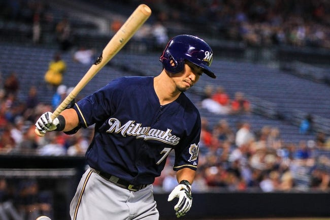 Sep 23, 2013; Atlanta, GA, USA; Milwaukee Brewers right fielder Norichika Aoki (7) runs to first after hitting a fly ball in the second inning against the Atlanta Braves at Turner Field. Mandatory Credit: Daniel Shirey-USA TODAY Sports