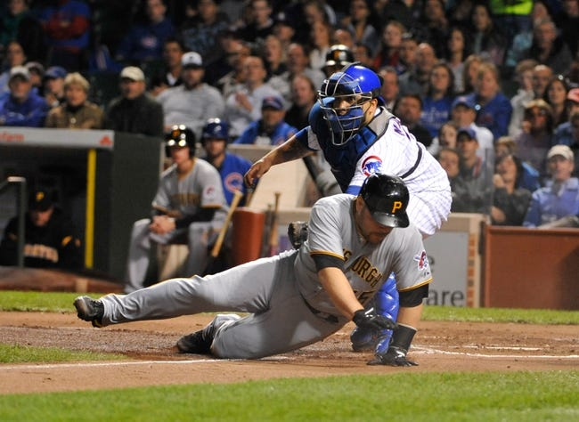Sep 23, 2013; Chicago, IL, USA; Pittsburgh Pirates catcher Russell Martin (55) gets tagged out by Chicago Cubs catcher Dioner Navarro (30) during the second inning at Wrigley Field. Mandatory Credit: David Banks-USA TODAY Sports