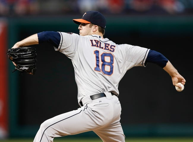 Sep 23, 2013; Arlington, TX, USA; Houston Astros starting pitcher Jordan Lyles (18) delivers a pitch to the Texas Rangers during the first inning of a baseball game at Rangers Ballpark in Arlington. Mandatory Credit: Jim Cowsert-USA TODAY Sports