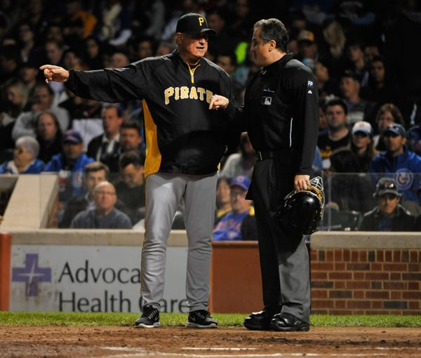 Sep 23, 2013; Chicago, IL, USA; Pittsburgh Pirates manager Clint Hurdle (13) argues a call with home plate umpire Mike DiMuro (16) during the fourth inning in a game against the Chicago Cubs at Wrigley Field. Mandatory Credit: David Banks-USA TODAY Sports