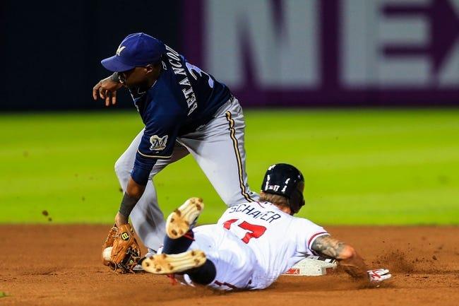 Sep 23, 2013; Atlanta, GA, USA; Atlanta Braves center fielder Jordan Schafer (17) steals second before Milwaukee Brewers second baseman Yuniesky Betancourt (3) can make the tag in the fourth inning at Turner Field. Mandatory Credit: Daniel Shirey-USA TODAY Sports