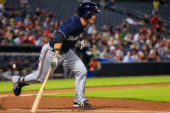 Sep 23, 2013; Atlanta, GA, USA; Milwaukee Brewers right fielder Norichika Aoki (7) hits a double in the fifth inning against the Atlanta Braves at Turner Field. Mandatory Credit: Daniel Shirey-USA TODAY Sports