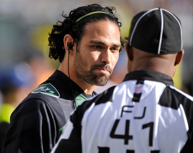 Sep 22, 2013; East Rutherford, NJ, USA; New York Jets quarterback Mark Sanchez (6) talks to the NFL field judge Boris Cheek during the game against the Buffalo Bills at MetLife Stadium. Mandatory Credit: Robert Deutsch-USA TODAY Sports