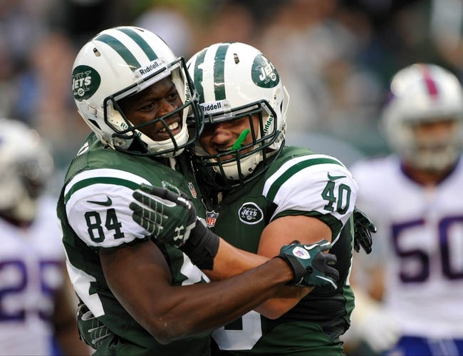 Sep 22, 2013; East Rutherford, NJ, USA; New York Jets fullback Tommy Bohanon (40) greets New York Jets wide receiver Stephen Hill (84) after a touchdown against the Buffalo Bills at MetLife Stadium. Mandatory Credit: Robert Deutsch-USA TODAY Sports