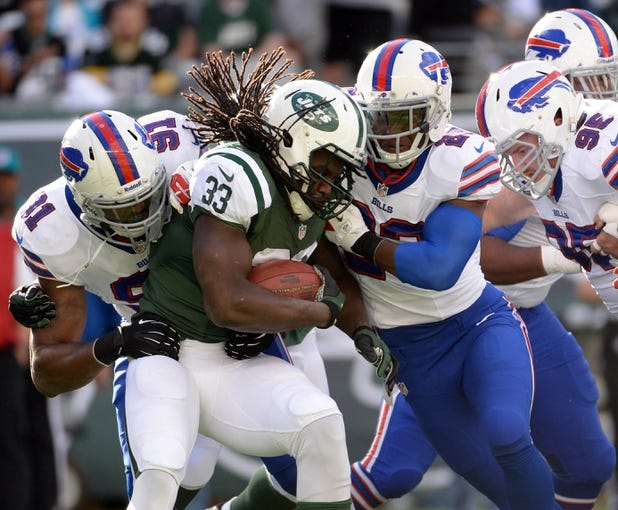 Sep 22, 2013; East Rutherford, NJ, USA; New York Jets running back Chris Ivory (33) stopped for a loss first play from scrimmage against the Buffalo Bills at MetLife Stadium. Mandatory Credit: Robert Deutsch-USA TODAY Sports