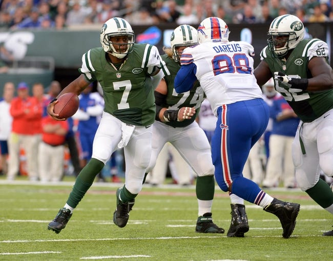 Sep 22, 2013; East Rutherford, NJ, USA; New York Jets quarterback Geno Smith (7) runs for a touchdown against the Buffalo Bills at MetLife Stadium. Mandatory Credit: Robert Deutsch-USA TODAY Sports