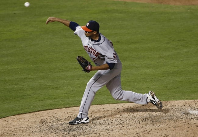 Sep 23, 2013; Arlington, TX, USA; Houston Astros relief pitcher David Martinez (54) delivers a pitch to the Texas Rangers during the fourth inning of a baseball game at Rangers Ballpark in Arlington. Mandatory Credit: Jim Cowsert-USA TODAY Sports