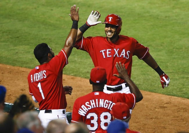 Sep 23, 2013; Arlington, TX, USA; Texas Rangers right fielder Alex Rios (51) is congratulated by shortstop Elvis Andrus (1) and manager Ron Washington (38) after his solo home run against the Houston Astros during the fourth inning of a baseball game at Rangers Ballpark in Arlington. Mandatory Credit: Jim Cowsert-USA TODAY Sports