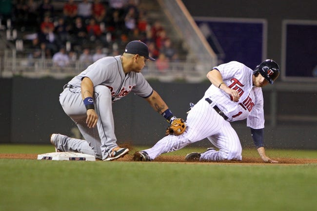Sep 23, 2013; Minneapolis, MN, USA; Detroit Tigers third baseman Miguel Cabrera (24) tags out Minnesota Twins outfielder Alex Presley (1) during the fifth inning against the Minnesota Twins at Target Field. Mandatory Credit: Brace Hemmelgarn-USA TODAY Sports