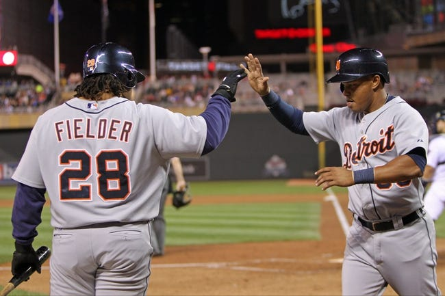 Sep 23, 2013; Minneapolis, MN, USA; Detroit Tigers shortstop Ramon Santiago (39) is congratulated by first baseman Prince Fielder (28) during the fifth inning against the Minnesota Twins at Target Field. Mandatory Credit: Brace Hemmelgarn-USA TODAY Sports
