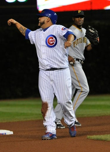 Sep 23, 2013; Chicago, IL, USA; Chicago Cubs catcher Dioner Navarro (30) reacts after being tagged out against the Pittsburgh Pirates during the seventh inning at Wrigley Field. Mandatory Credit: David Banks-USA TODAY Sports