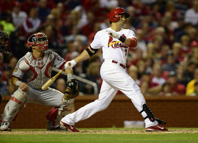 Sep 23, 2013; St. Louis, MO, USA; St. Louis Cardinals right fielder Carlos Beltran (3) hits a two run home run off of Washington Nationals starting pitcher Tanner Roark (not pictured) during the fifth inning at Busch Stadium. Mandatory Credit: Jeff Curry-USA TODAY Sports