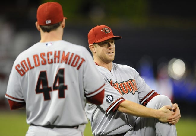 Sep 23, 2013; San Diego, CA, USA; Arizona Diamondbacks second baseman Aaron Hill (right) talks with first baseman Paul Goldschmidt (44) prior to the game against the San Diego Padres at Petco Park. Mandatory Credit: Christopher Hanewinckel-USA TODAY Sports