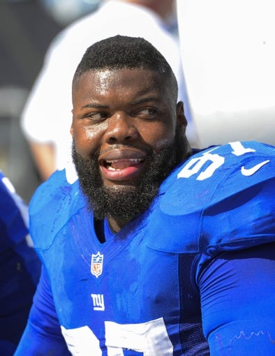 Sep 22, 2013; Charlotte, NC, USA; New York Giants defensive tackle Linval Joseph (97) on the sidelines. The Carolina Panthers defeated the New York Giants 38-0 at Bank of America Stadium. Mandatory Credit: Bob Donnan-USA TODAY Sports