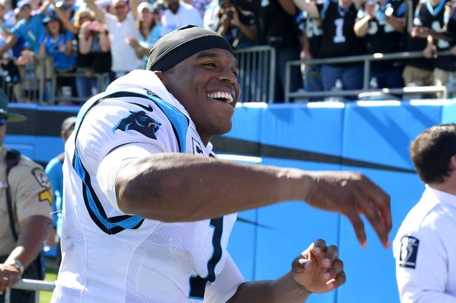 Sep 22, 2013; Charlotte, NC, USA; Carolina Panthers quarterback Cam Newton (1) reacts as he is leaving the field after the game. The Carolina Panthers defeated the New York Giants 38-0 at Bank of America Stadium. Mandatory Credit: Bob Donnan-USA TODAY Sports