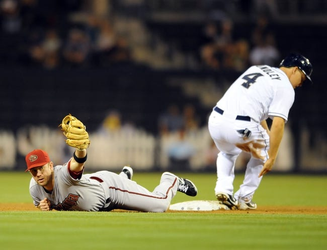 Sep 23, 2013; San Diego, CA, USA; Arizona Diamondbacks second baseman Aaron Hill (right) shows the ball after a force out on San Diego Padres catcher Nick Hundley (4) during the second inning at Petco Park. Mandatory Credit: Christopher Hanewinckel-USA TODAY Sports