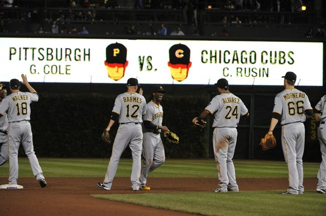 Sep 23, 2013; Chicago, IL, USA; The Pittsburgh Pirates celebrate their win against the Chicago Cubs at Wrigley Field. The Pittsburgh Pirates defeated the Chicago Cubs 2-1.Mandatory Credit: David Banks-USA TODAY Sports