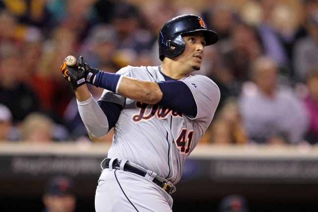 Sep 23, 2013; Minneapolis, MN, USA; Detroit Tigers designated hitter Victor Martinez (41) hits a RBI double during the seventh inning against the Minnesota Twins at Target Field. Mandatory Credit: Brace Hemmelgarn-USA TODAY Sports