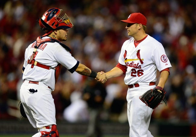 Sep 23, 2013; St. Louis, MO, USA; St. Louis Cardinals relief pitcher Trevor Rosenthal (26) is congratulated by catcher Yadier Molina (4) after closing out the ninth inning against the Washington Nationals at Busch Stadium. St. Louis defeated Washington 4-3. Mandatory Credit: Jeff Curry-USA TODAY Sports