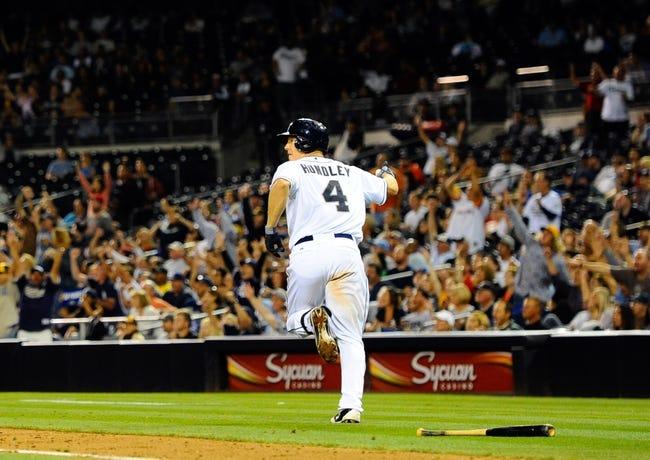 Sep 23, 2013; San Diego, CA, USA; San Diego Padres catcher Nick Hundley (4) runs the bases following a three-run home run down the third base line during the sixth inning against the Arizona Diamondbacks at Petco Park. Mandatory Credit: Christopher Hanewinckel-USA TODAY Sports