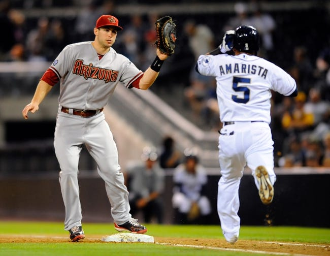Sep 23, 2013; San Diego, CA, USA; Arizona Diamondbacks first baseman Paul Goldschmidt (44) catches the ball in the baseline on a ground out by San Diego Padres center fielder Alexi Amarista (5)during the fifth inning at Petco Park. Mandatory Credit: Christopher Hanewinckel-USA TODAY Sports