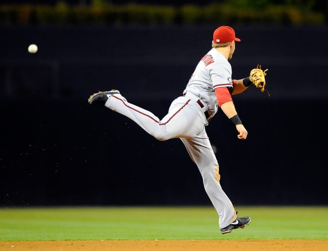 Sep 23, 2013; San Diego, CA, USA; Arizona Diamondbacks shortstop Cliff Pennington (4) is unable to catch a line drive hit up the middle during the sixth inning against the San Diego Padres at Petco Park. Mandatory Credit: Christopher Hanewinckel-USA TODAY Sports