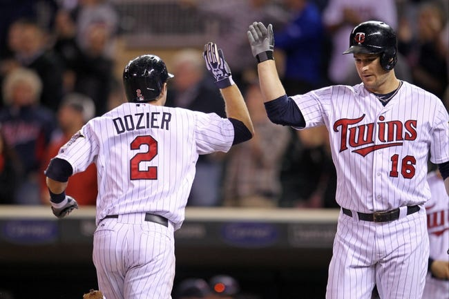 Sep 23, 2013; Minneapolis, MN, USA; Minnesota Twins second baseman Brian Dozier (2) is congratulated by outfielder Josh Willingham (16) after hitting a home run during the ninth inning against the Detroit Tigers at Target Field. The Twins defeated the Tigers 4-3. Mandatory Credit: Brace Hemmelgarn-USA TODAY Sports