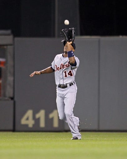 Sep 23, 2013; Minneapolis, MN, USA; Detroit Tigers outfielder Austin Jackson (14) catches a fly ball during the seventh inning against the Minnesota Twins at Target Field. The Twins defeated the Tigers 4-3. Mandatory Credit: Brace Hemmelgarn-USA TODAY Sports