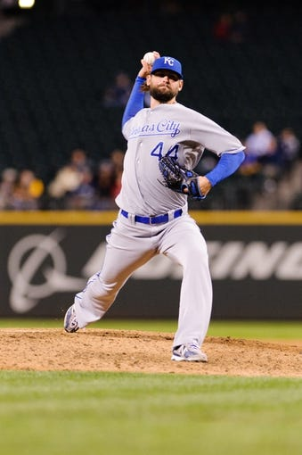 Sep 23, 2013; Seattle, WA, USA; Kansas City Royals relief pitcher Luke Hochevar (44) pitches to the Seattle Mariners during the 8th inning at Safeco Field. Mandatory Credit: Steven Bisig-USA TODAY Sports