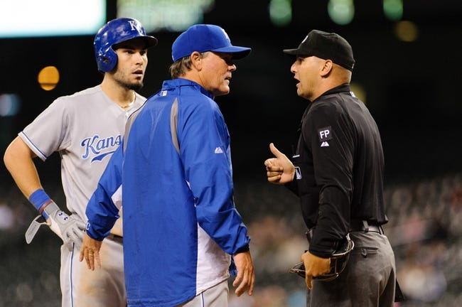 Sep 23, 2013; Seattle, WA, USA; Kansas City Royals manager Ned Yost (3) argues with home plate umpire Vic Carapazza (85) after Kansas City Royals pinch hitter Johnny Giavotella (9) struck out during the 10th inning against the Seattle Mariners at Safeco Field. Mandatory Credit: Steven Bisig-USA TODAY Sports
