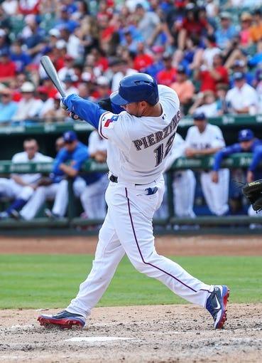 Sep 15, 2013; Arlington, TX, USA; Texas Rangers catcher A.J. Pierzynski (12) bats during the game against the Oakland Athletics at Rangers Ballpark in Arlington. Oakland won 5-1. Mandatory Credit: Kevin Jairaj-USA TODAY Sports