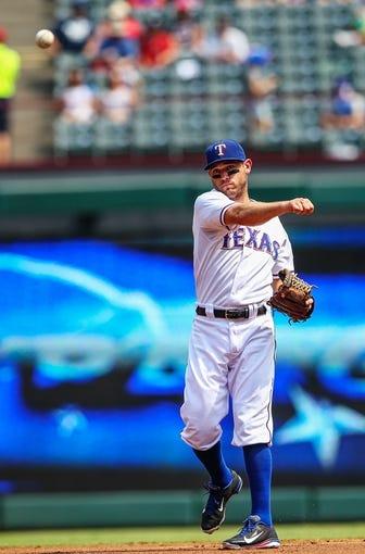 Sep 15, 2013; Arlington, TX, USA; Texas Rangers second baseman Ian Kinsler (5) throws during the game against the Oakland Athletics at Rangers Ballpark in Arlington. Oakland won 5-1. Mandatory Credit: Kevin Jairaj-USA TODAY Sports