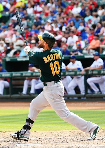 Sep 15, 2013; Arlington, TX, USA; Oakland Athletics first baseman Daric Barton (10) bats during the game against the Texas Rangers at Rangers Ballpark in Arlington. Oakland won 5-1. Mandatory Credit: Kevin Jairaj-USA TODAY Sports