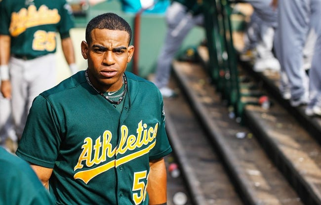 Sep 15, 2013; Arlington, TX, USA; Oakland Athletics designated hitter Yoenis Cespedes (52) in the dugout during the game against the Texas Rangers at Rangers Ballpark in Arlington. Oakland won 5-1. Mandatory Credit: Kevin Jairaj-USA TODAY Sports