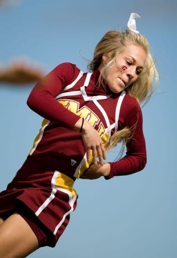 Sep 21, 2013; Mount Pleasant, MI, USA; Central Michigan Chippewas cheer team member performs before the game against the Toledo Rockets at Kelly/Shorts Stadium. Rockets beat the Chippewas 38-17. Mandatory Credit: Raj Mehta-USA TODAY Sports