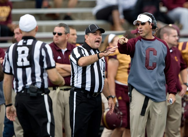 Sep 21, 2013; Mount Pleasant, MI, USA; Central Michigan Chippewas head coach Dan Enos talks to a referee during the second quarter against the Toledo Rockets at Kelly/Shorts Stadium. Rockets beat the Chippewas 38-17. Mandatory Credit: Raj Mehta-USA TODAY Sports