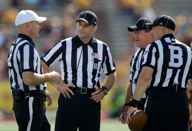 Sep 21, 2013; Mount Pleasant, MI, USA; The referees have a conference during the second quarter at Kelly/Shorts Stadium. Toledo Rockets beat the Central Michigan Chippewas 38-17. Mandatory Credit: Raj Mehta-USA TODAY Sports